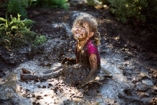 girl-playing-in-mud
